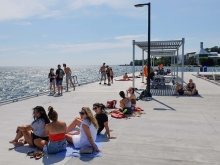 The pier's south side and shade structure give a front row south-facing seat over a long fetch of Lake Ontario