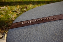 Each individual place-marker incorporates a bronze band with a word or phrase