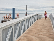 The bridge inflection offers a high vantage lookout, offering uninterrupted sight lines between the beach spaces below